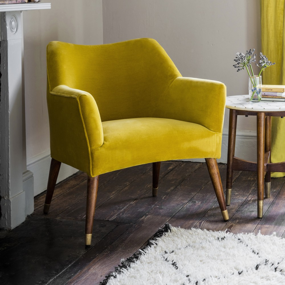 Astoria chair in mustard yellow velvet with brass caps for Armchair furniture